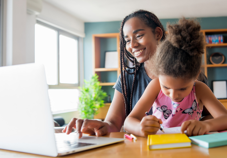 Main mother helping and supporting her daughter with online school while staying at home new normal lifestyle concept monoparental concept